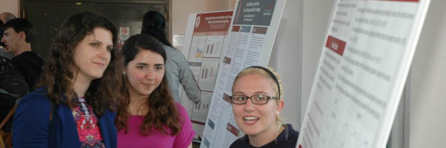 Clinical students discussing research at a conference.