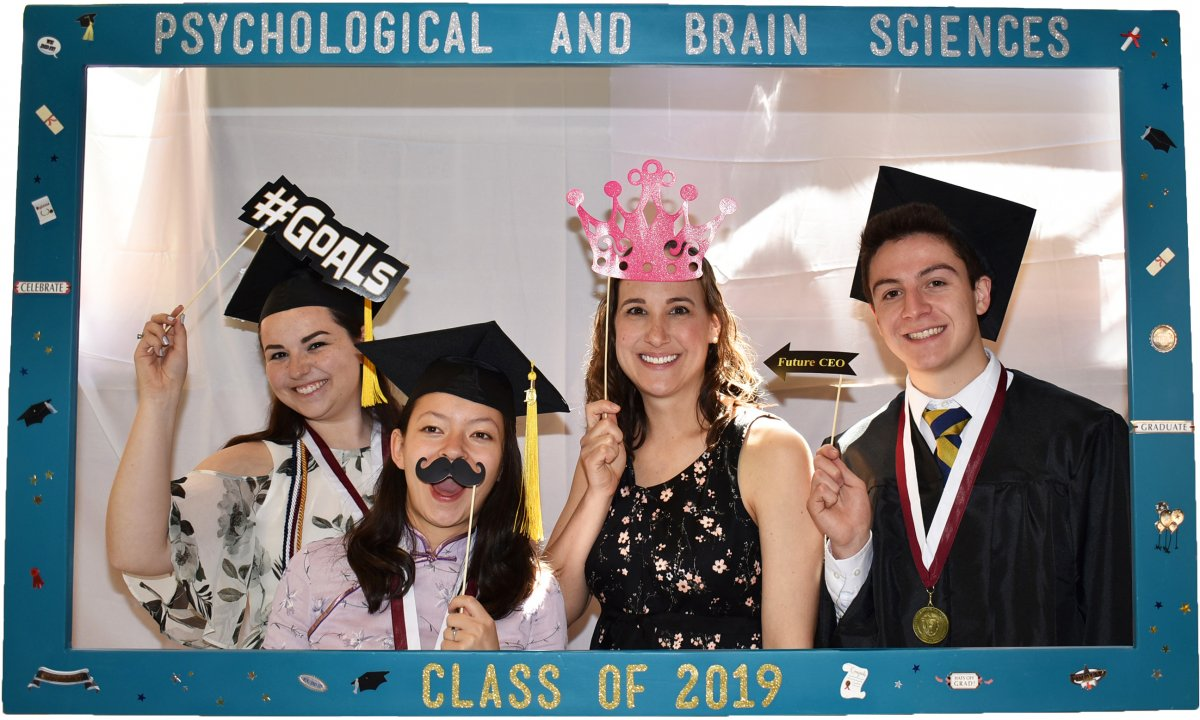 graduates pose with funny mustaches and hats