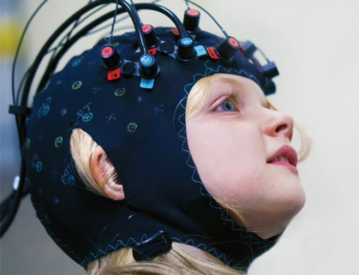 child with FNIRS cap on