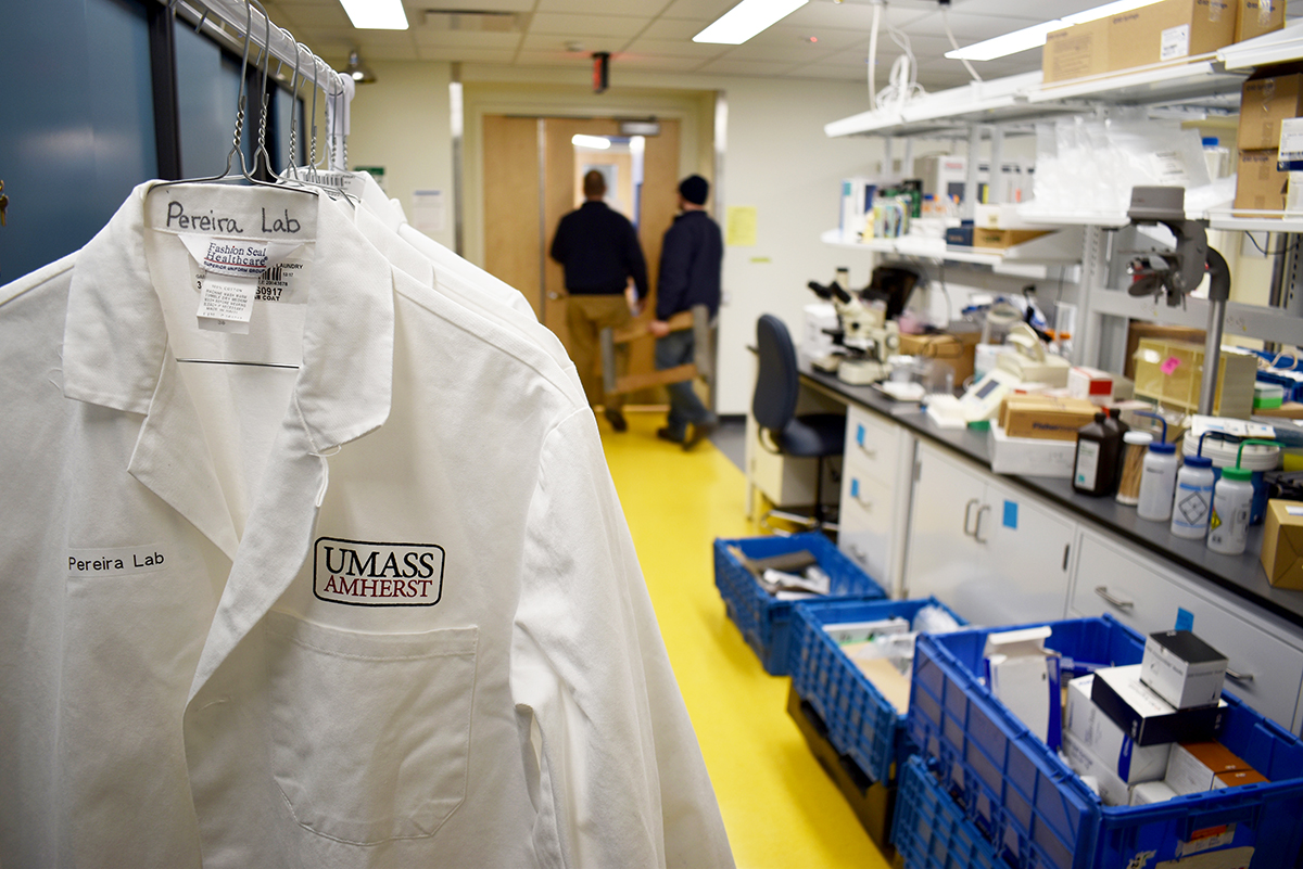 lab coats hang in new space