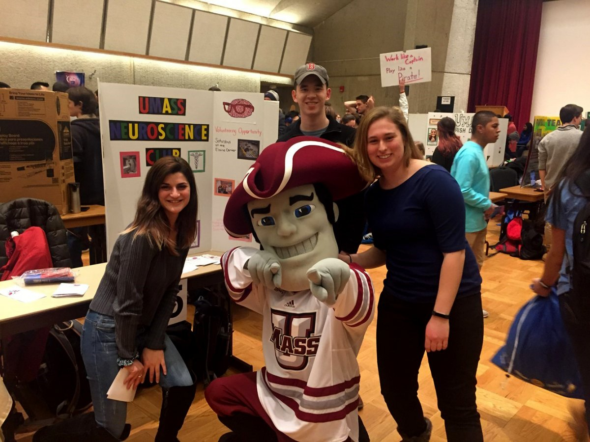 club members at student fair with sam the minuteman