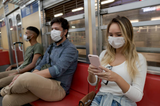 people on the subway wearing face masks