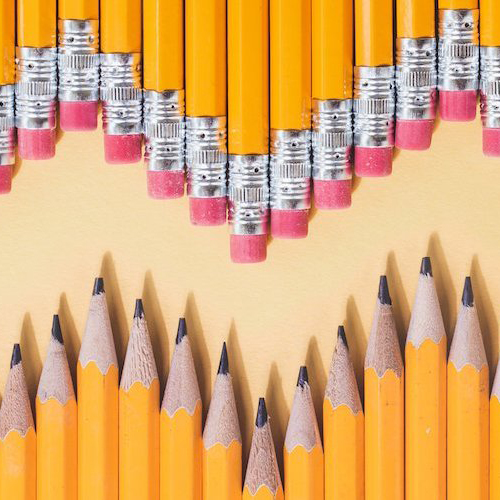 pencils lined up on a desk