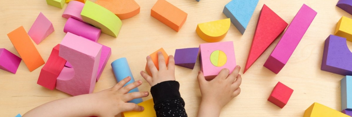 children's hands play with blocks