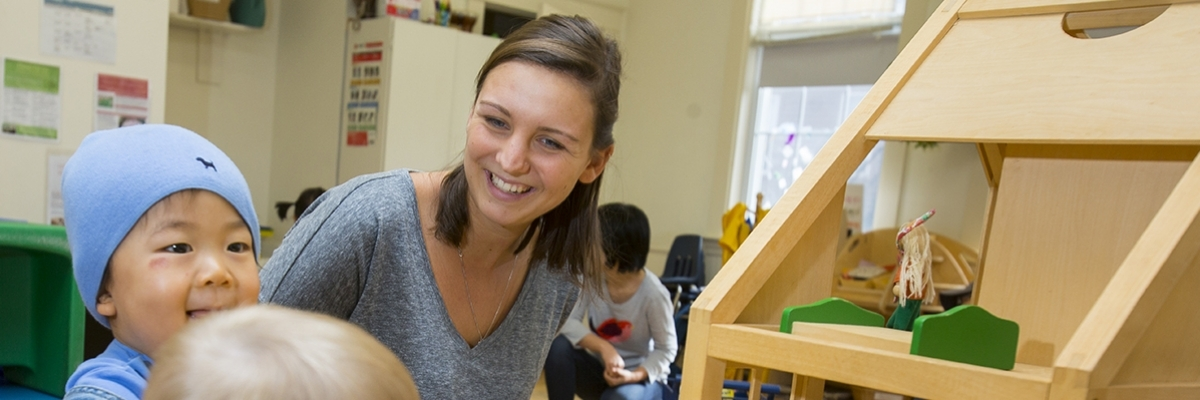 DDHS student works with toddler in classroom