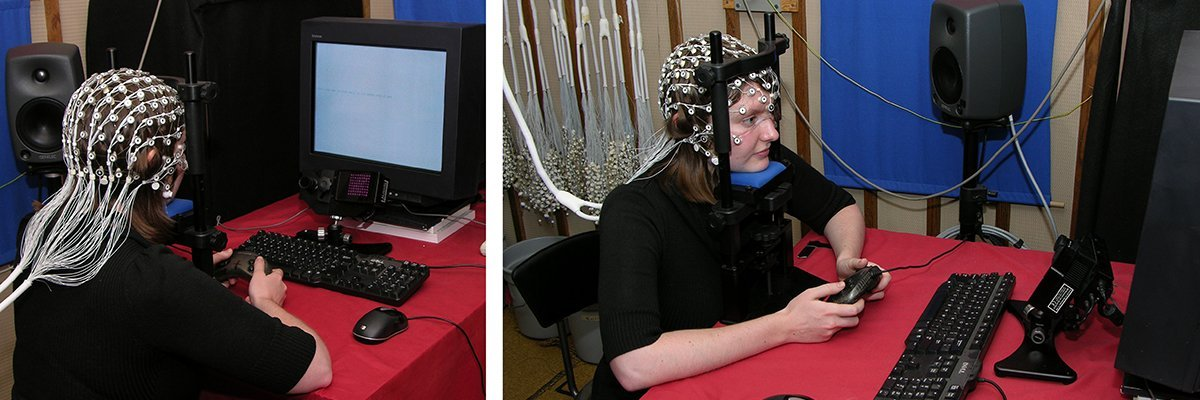 female student reads text onscreen wearing EEG cap