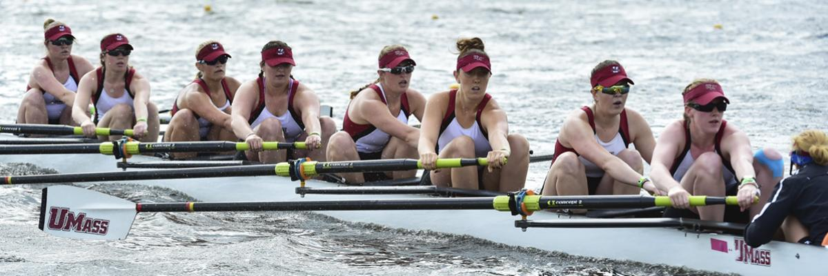 womens rowers compete in river race